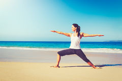 Beach Yoga, Healthy Lifestyle. Healthy Lifestyle Concept, Beautiful young woman stretching practicing yoga on the beach Stock Photo