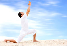 Beach yoga - man Royalty Free Stock Photo