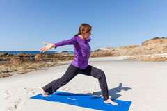 Beach Yoga Practice Royalty Free Stock Images
