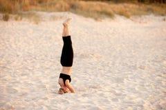 Beach yoga session by polish sea Royalty Free Stock Photography