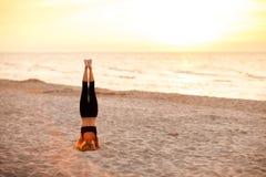 Beach yoga session by polish sea Royalty Free Stock Image