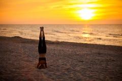 Beach yoga session by polish sea Stock Photo