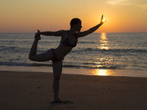 Beach yoga at sunset Royalty Free Stock Image