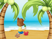 A beach with a young girl playing Stock Images