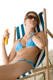 Beach - Young woman apply suntan lotion Royalty Free Stock Photography