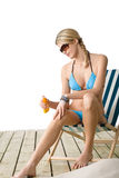 Beach - Young woman apply suntan lotion Royalty Free Stock Photo