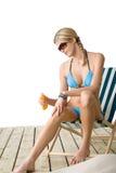 Beach - Young woman apply suntan lotion Royalty Free Stock Photo