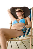 Beach - Young woman in bikini on deckchair Royalty Free Stock Images