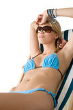 Beach - Young woman in bikini sit on deck chair Stock Images