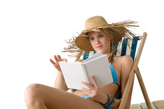 Beach - Young woman relax with book in bikini Stock Photo
