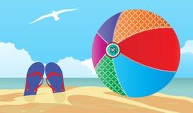 Beachball和啪嗒啪嗒的响声在海滩 免版税库存图片