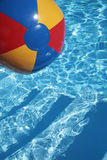 Beachball in a beautiful blue swimming pool royalty free stock photo