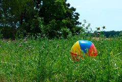 Beachball blown into a field royalty free stock images