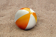 Beachball in the sand Royalty Free Stock Image