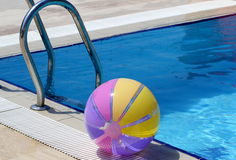 Beachball and swimmingpool. Summer vacations Royalty Free Stock Photos
