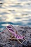 Beachchair на камне Стоковое Изображение RF