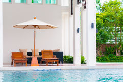 Beachchair and swimming pool Royalty Free Stock Image