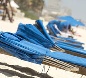 Beachchairs on the sand in Cancun, Mexico Stock Image