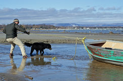 Beachcomber finds a boat. Severe flooding and spring storms on Georgian Bay wash an old aluminum boat ashore Royalty Free Stock Photos