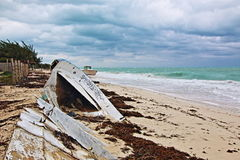 Beached Abandoned Boat Skiff on Isla Blanca peninsula on Cancun Bay Mexico. Beached Wrecked Abandoned Boat Skiff on Isla Blanca peninsula on Cancun Bay Mexico Royalty Free Stock Images