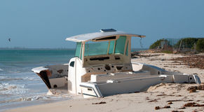 Beached Abandoned Boat Skiff on Isla Blanca peninsula on Cancun Bay Mexico. Beached Wrecked Abandoned Boat Skiff on Isla Blanca peninsula on Cancun Bay Mexico Stock Photo
