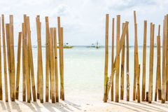A Beached Bamboo fence. Royalty Free Stock Image