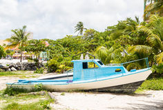 Beached Blue and White Boat stock image