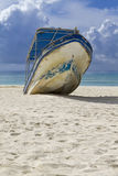 Beached Boat. A beached boat waiting for high tided Royalty Free Stock Photography
