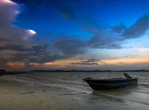 Beached Boat. Boat beached at low tide at dusk stock photos