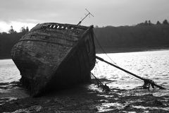 Beached Boat. Black & White image of boat on th ebeach Stock Photography