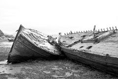 Beached Boat. Black & White image of boat on th ebeach Royalty Free Stock Images