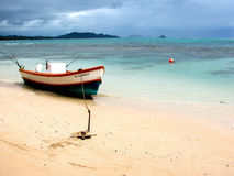 Beached boat. A resting boat along the shores of a beach on Oahu, Hawaii Royalty Free Stock Photography