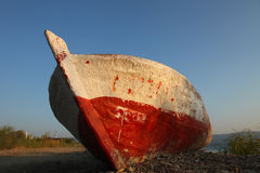 Beached boat. A decayed wooden fishing boat beached on the shores of Lake Iznik, Çakırca, Turkey royalty free stock photography