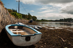 Beached boat at low tide. Low tide at Kenmare harbour Royalty Free Stock Images