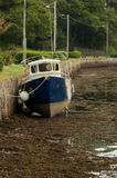 Beached boat at low tide. Low tide at Kenmare harbour Royalty Free Stock Photo