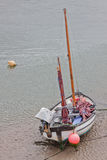 Beached boat at low tide Royalty Free Stock Image