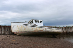 Beached boat in New Brunswick, Canada Stock Photography