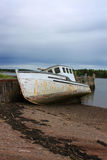 Beached boat in New Brunswick, Canada Stock Photo