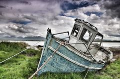 Beached boat at Roundstone Royalty Free Stock Photos