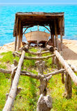 Beached boat in wood railway at Formentera Stock Photography