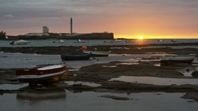 Beached Boats at Sunset Cadiz Spain stock image