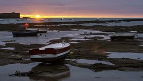 Beached Boats at Sunset Cadiz Spain stock images