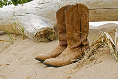 Western boots in beach sand stock photos