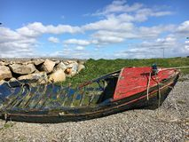 Beached. Broken boat beached in Galway royalty free stock images