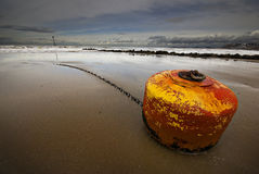 Beached buoy Stock Photography