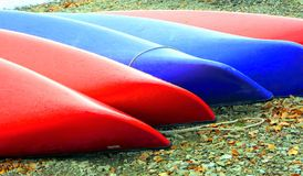 Beached canoes. Colorful beached canoes on the banks of Derwent Water, Lake District National Park, Cumbria, England, UK royalty free stock images