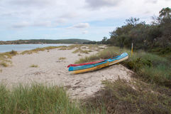 Beached Canoes stock photography