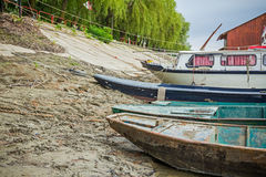 Beached fisherman boat, tied to a tree. Stock Image