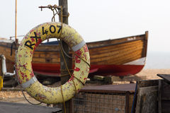 Beached fishing boat with lifebuoy in Kent, England Stock Photography