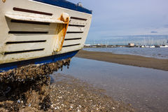 Beached Fishing Boat. A fishing boat washed up on a beach from a  recent storm in Melbourne Stock Image